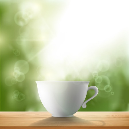 warm drink: white cup standing on a wooden table in the garden