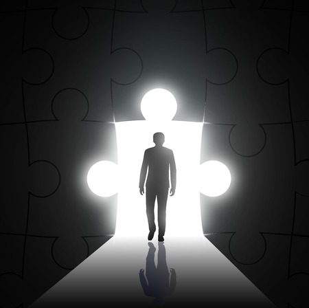 overcoming adversity: silhouette of man on a background of the hole in the form of puzzles