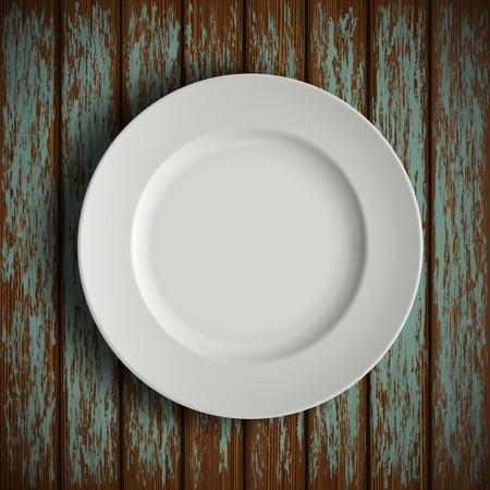 plato de comida: plato blanco sobre la mesa de madera vieja