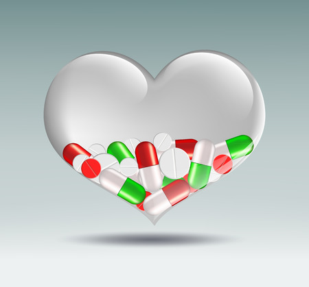 medication: human heart of a transparent glass which contains medication