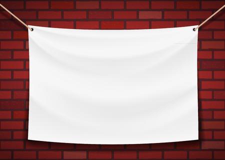 pancarta: bandera blanca colgando de un fondo de la pared de ladrillo