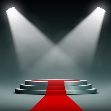 spotlights illuminate the pedestal with red carpet