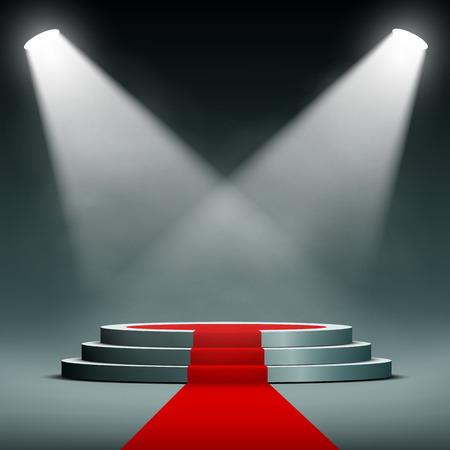 spotlights illuminate the pedestal with red carpet