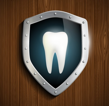 fluorine: human tooth on the background of the shield
