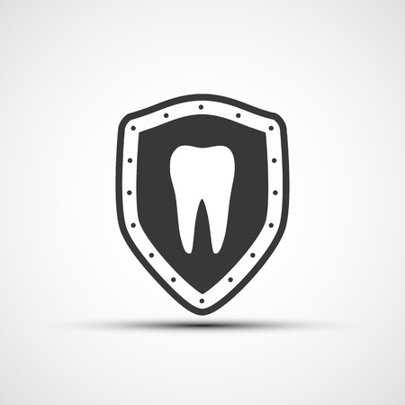 carious: Vector shield with a human tooth