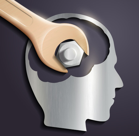 human head and a wrench with a nut