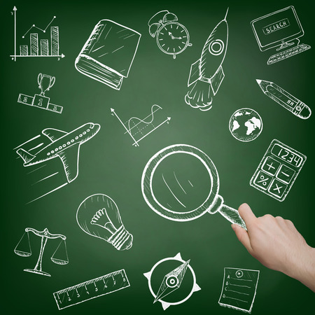 magnifying glass: Man holding a magnifying glass. Doodle icons drawn on the board Stock Photo
