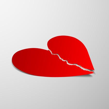 paper heart: Broken red heart on a light background