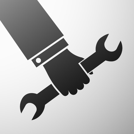 machinist: Human hand holding a wrench.