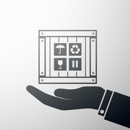 packer: Human hand holding a wooden box.