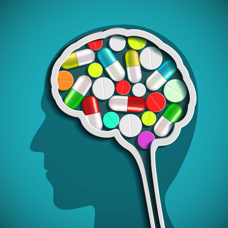 Human head with the brain and pills.