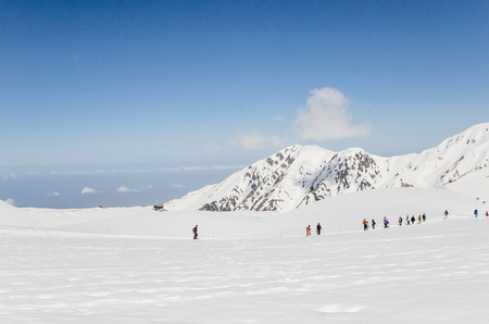 sledging people: Winter landscape and people walking in the snow Stock Photo