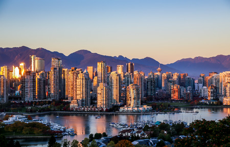Vancouver cityscape catches the setting sun on a beautiful autumn evening with the warm light reflecting off the highrises