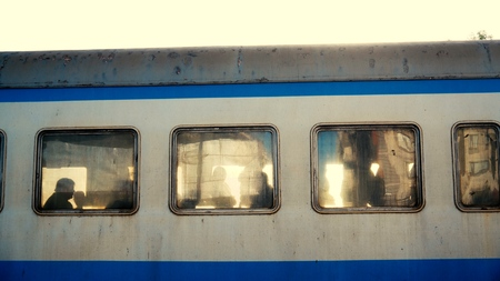 Curious people looking out of a train windows 写真素材