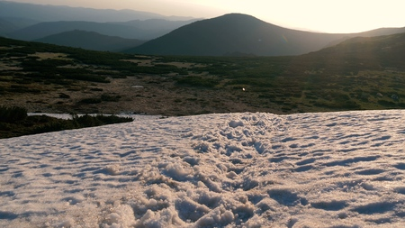 Mountain top covered with snowy drifts in the Carpathians in autumn 写真素材