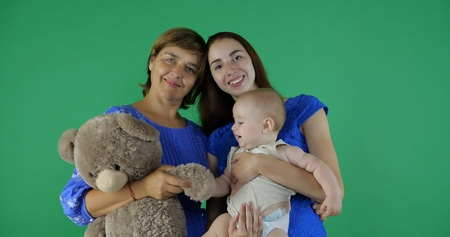 4k - happy family of 3 generation of woman on green screen.