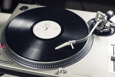 DJ mixer with a vinyl record, close up.