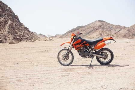 Egypt Sharm el sheikh - august 2016: The bike KTM is parked in the desert without people Editorial