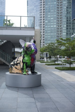 Singapore - 01 November 2014: Modern art sculpture of artistic dog with graffiti on the street