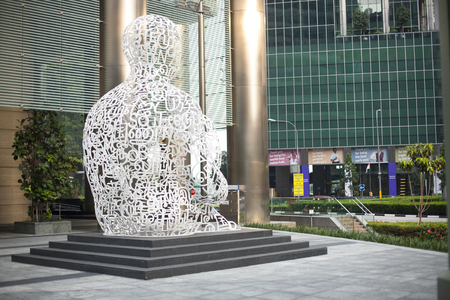 Singapore - 01 November 2014: Giant Sculpture of a Man Made of Letters by artist Jaume Plensa Editorial