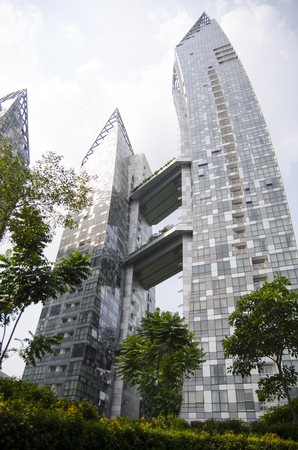 public housing: Singapore, Republic of Singapore - 05 November, 2014: Cityscape skyscraper architecture sunset view of downtown