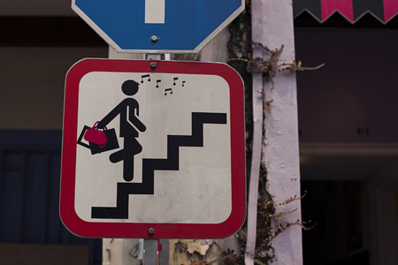 stair: Road sign with glamor woman on stair