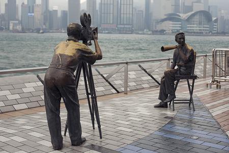 filmmaker: Hong Kong, China - November 07, 2014: Film director and cameraman on set monument