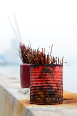 Used red and magenta incense sticks in a temple Malaysia