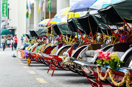 rikscha: Vintage Trishaw stop beside road for service traveller