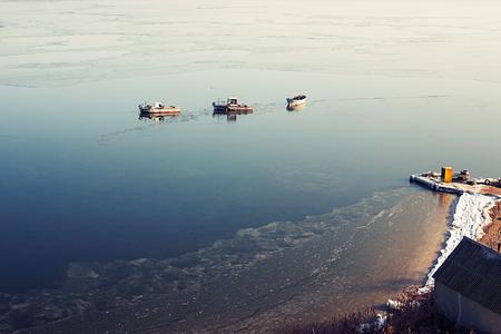 A few small ships in the sea near coast