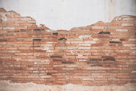 foundation problems: Old ruined brick wall with peelling of plaster Stock Photo
