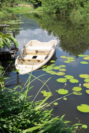 sunken boat: Old sunken plastic boat
