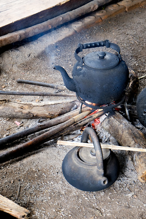 traditional water boiling by firewood photo