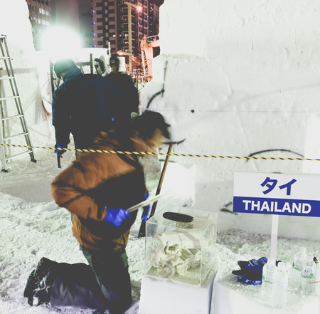 odori: SAPPORO, JAPAN - FEBRUARY 2015: Motion of snow sculptor in the International Snow Sculpture Contest 2015 on February 4, 2015 at Odori site in Sapporo, Japan. Thailand team is the winner of