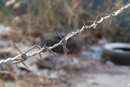 wasteland: Barb wire in blurred background of wasteland