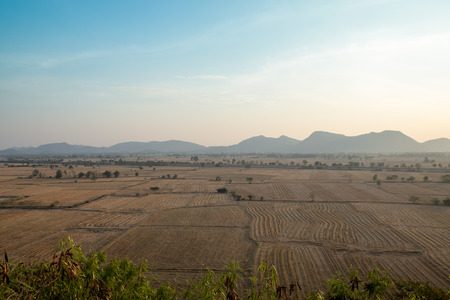 cropland: Cultivated farmland with mountain landscape Stock Photo