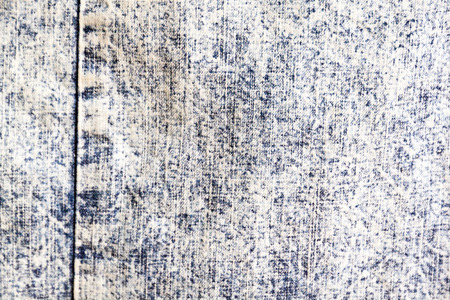 blue denim: Pale blue denim textile with seam