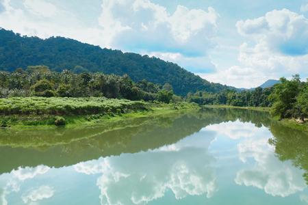river scape: Sky reflection in lake at Nakhon Si Thammarat, Thailand Stock Photo