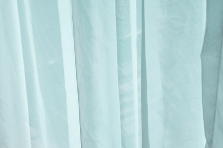 crease: Light green fabric curtain with crease Stock Photo