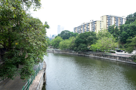 shady: Peaceful riverview in urban with shady tree Stock Photo