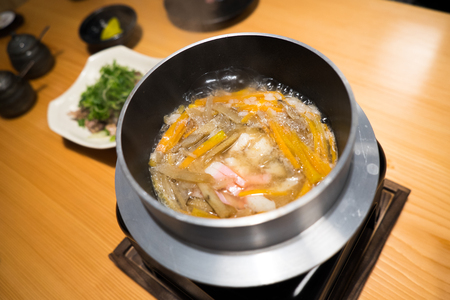 Japanese boiled rice served with mini hot pot Banco de Imagens