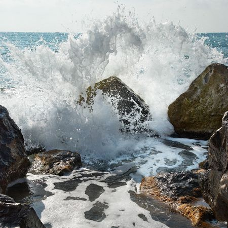 Storm. Big stone covered by waves.