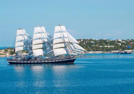 Sailing ship entering to the bay.