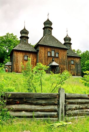 Wooden church with the wooden fence. photo