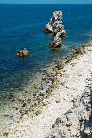 A coastline with many big rocks. photo