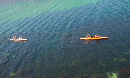 sculling: Kayakers sculling on the sea.