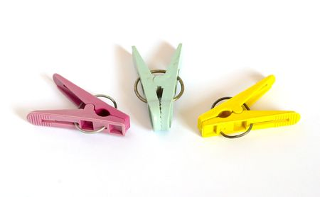 clothespegs: Colored clothes-pegs isolated on white.