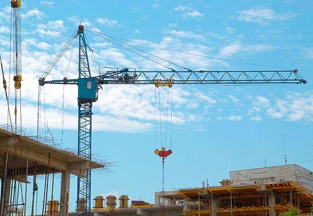 Building crane abd the building under construction.
