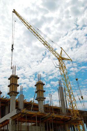 Building crane abd the building under construction. Stock Photo - 3389972