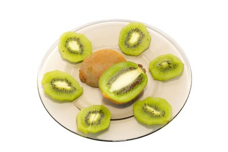 cathartic: Fresh kiwi on the plate isolated on white. Stock Photo